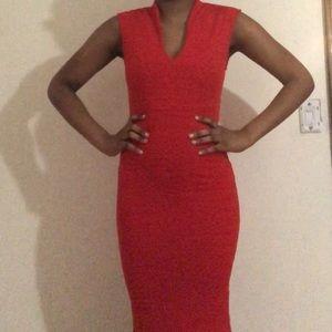 🦋Orange body fitting mid length dress